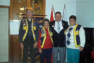 District Governor Earl Einarson presenting Lion Royce Vaughan - 400 Visitation Pin, President Florence Vaughan - 200 Visitation Pin and Lion Wendy Blue - 50 Visitation Pin