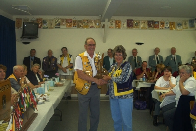 Lion Florence accepting Best Club Runner Up Trophy from PDG Harry Currie