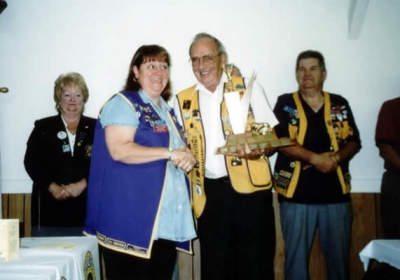 President Dallas Moore accepting Best Club Runner-Up Trophy District 41N2 2003-2004 from PDG Harry Currie