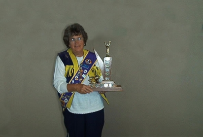 Past President Florence Vaughan displays the BEST RUNNER-UP TROPHY District 41N2 2002-2003