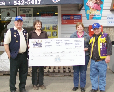Lion Allan & Lion Bucky with Joyce Cann from Cann's Convience on left presenting Bingo cheque to Tina Merrett on right.