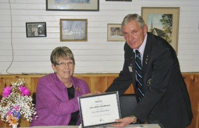 VDG Wayne Little presenting Lion Millie MacKenzie with Life Membership Lions Foundation of Canada