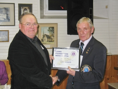 VDG Wayne Little presenting Lion Allan Chambers with Life Membership Lions Foundation of Nova Scotia