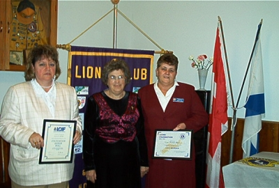 President Florence Vaughan presenting LCIF Honor Roll Certificate to Lion Dallas Moore and Lions Foundation District 41N2 LIfe Member Certificate to Lion Wendy Blue.