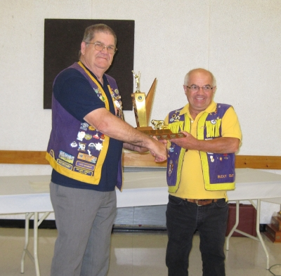 Lion Bucky accepting Best Runner-Up Club Trophy 2010-2011 District N2 from PDG Earl Einarson