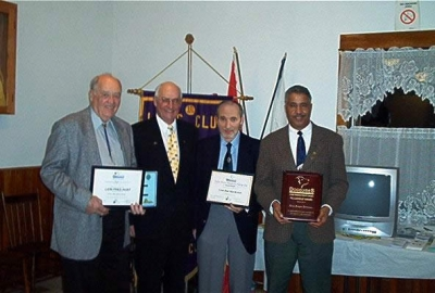 PDG Charles Uhlman presenting Lion Fred Hunt with Life Membership Award LFC, Lion Ken MacKenzie with Judge Brian Stevenson Fellowship Award and Lion Angus Johnson with Lions Foundation Canada Fellowship Award.