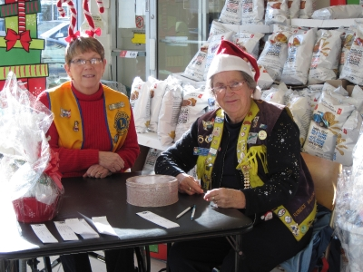 Lions Millie & Florence selling Christmas Basket Tickets