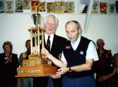 Lion Ken MacKenzie accepting Outstanding Lion of Year Trophy District 41N2 2003-2004 from PDG Art MacKenzie