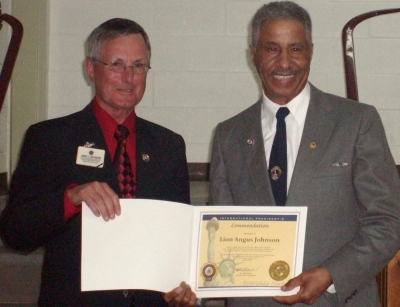 PID Jim Sherry presenting Lion Angus Johnson with International Presidents Certificate Appreciation