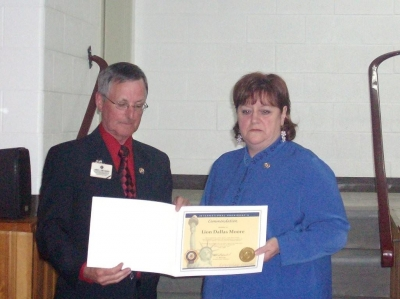PID Jim Sherry presenting Lion Dallas Moore with International Presidents Certificate Appreciation