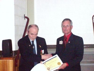 PID Jim Sherry presenting Lion Ken MacKenzie with International Presidents Certificate Appreciation