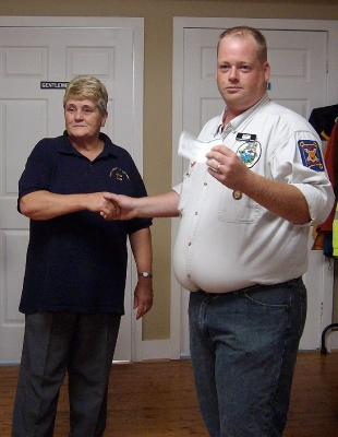 Lion Wendy Blue presenting a cheque to Hants West Ground Search & Rescue purchasing 2 Project Lifesaver Transmitter Bracelets