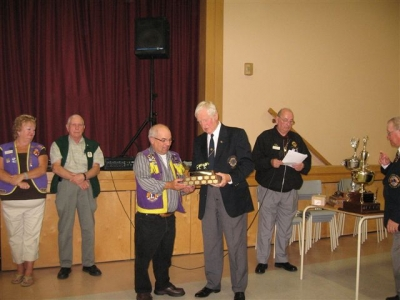 Past President Bucky Smith accepting the PDG Art MacKenzie Best Web Site Trophy District N2 2007-2008 from PDG Art MacKenzie